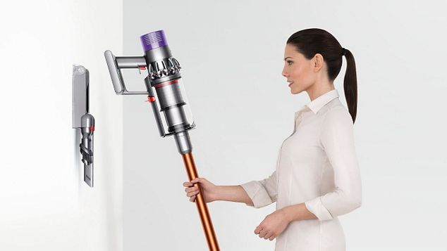 Hanging Up a Cordless Handheld Dyson V10 Absolute Vacuum Cleaner